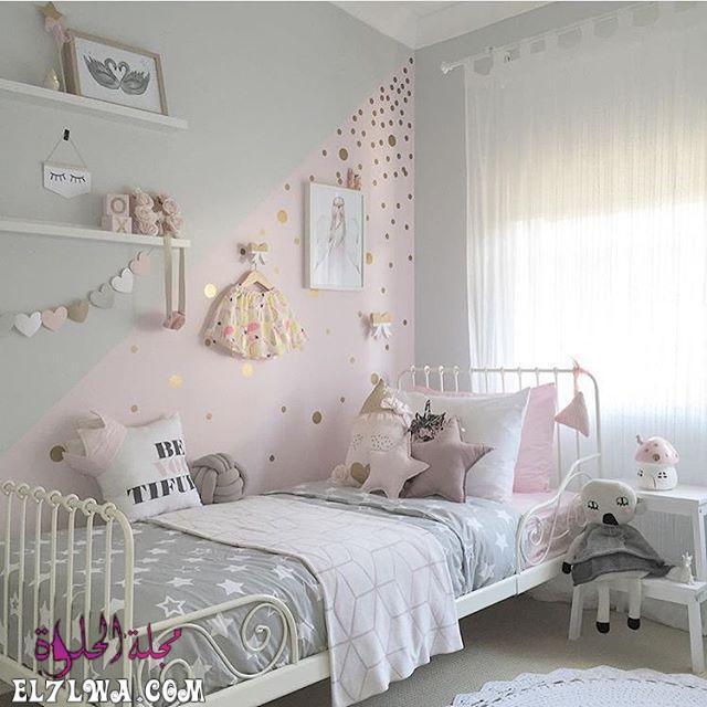 غرفة نوم بتصميم شيك مع رسومات رائعة على الحائط وسرير حديدى بتصميم حلو جداً باللون الابيض 1 - ديكورات غرف نوم بنات 2021 صور ديكور غرف نوم للبنات