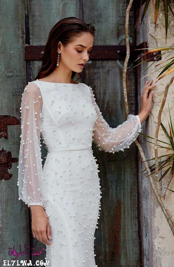 فستان زفاف بأكمام من التل المزين باللؤلؤ
