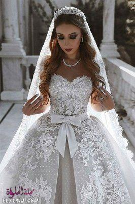 فساتين زفاف دانتيل منفوشة بدون أكمام