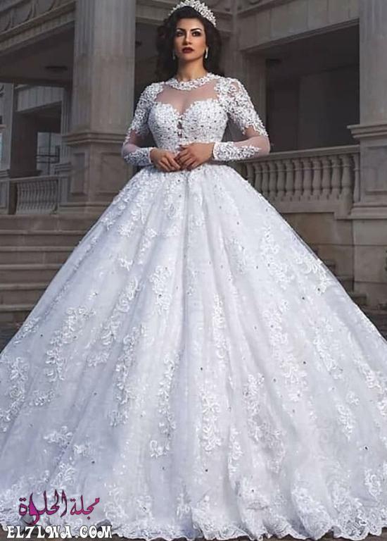 فساتين زفاف دانتيل منفوشة بأكمام طويلة